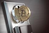 Pay by bitcoin concept. BItcoin coin and coin acceptor.