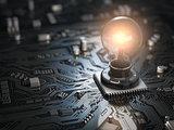 Glowing light bulb as CPU on motherboard circuit board. Idea cre