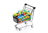 Round coated sweet candies in shopping cart