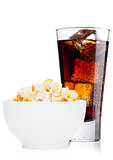 Popcorn salty sweet snack in white bowl with cola