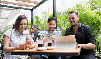 Three friends using devices connected to the wireless internet n
