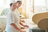 Baker women working in bakehouse of bakery