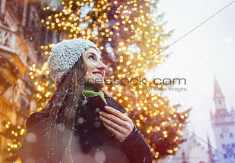 Woman enjoying Christmas time in the city