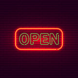 Open neon sign on brick wall. Vintage signboard