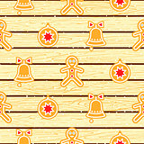 Gingerbread cookies on wood planks vector seamless pattern.