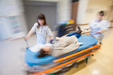 Emergency Hospital Nurses Pushing Litter Patient