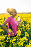 Mixed Race African American Girl Teenager Runner Drinking Water