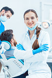 Portrait of a confident female dentist looking at camera in the