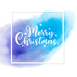 Christmas card with blue watercolor texture.