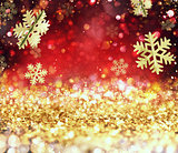 Abstract glowing Christmas gold and red background with snowflakes