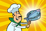 Chef cook character with roasted fish