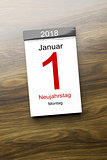 a calendar the 1st of January new year day text in german langua