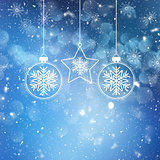 Christmas baubles on snowflake and stars background