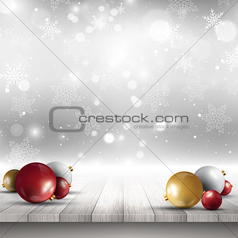 Christmas baubles on wooden deck