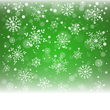 Christmas snowflakes and snowdrift on green background.