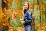 Pretty girl in autumn forest