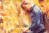 Beautiful model in autumn park