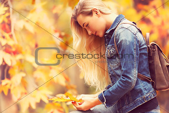 Beautiful model in autumn park