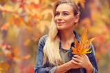 Beautiful girl enjoying autumn holidays