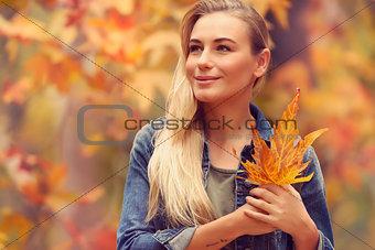 Beautiful girl enjoying autumn holidays