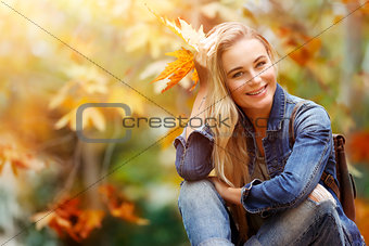 Happy female in autumn forest