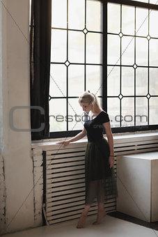 Ballerina near window