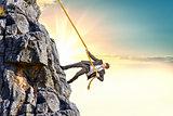 Businessman climb a mountain
