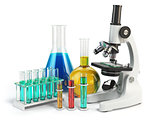 Microscope with flasks and vials. Chemistry labratory tools.