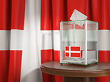 Ballot box with flag of Denmark and voting papers. Danish presid