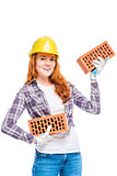 strong woman builder in yellow breeze with bricks on white backg