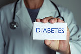 doctor and signboard with text diabetes