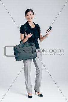 attractive business woman on gray background