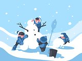 Children build snowman in winter