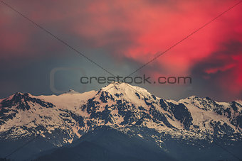 Sunset evening view over the snowy mountain peak
