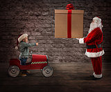 Santa Claus deliver a CHristmas gift to a child