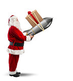 Fast delivery of Christmas gifts. Santa Claus ready to launch a rocket