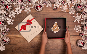 Presenting a christmas gift box - with gingerbread cookie inside