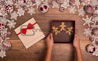 Giving or receiving gingerbread people cookies as christmas pres