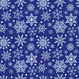 Snowflakes on blue background seamless texture
