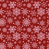 Snowflakes on red background seamless texture