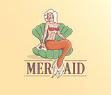 Logo with a mermaid sitting on a shell