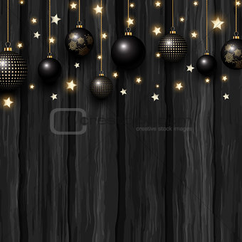 Christmas baubles and stars on a grunge wooden texture