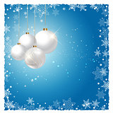 Christmas baubles on snowflake background
