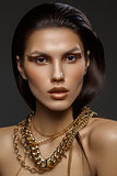 beautiful girl with many golden and bronze chains