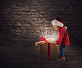Child that open a magic Christmas gift