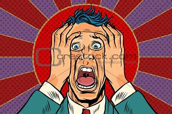 terrified man holding his head, panic face