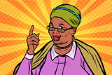 African elderly woman pointing finger up