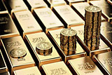Bitcoin piles on rows of gold bars (gold ingots)
