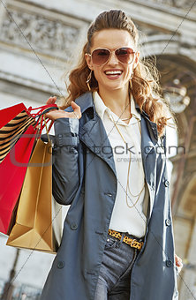 smiling young fashion-monger with shopping bags in Paris, France