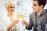 Couple clinking with sparkling wine for Christmas
